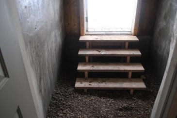 Steps down into the Root Cellar